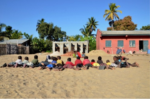Even in the summertime, pupils are always around the school to see the day to day changes. Tsimahavaobe primary school, Morondava commune, Menabe region, Madagascar. July 2013.