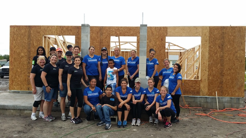 The building crew for Maria's house included Maria's supportive co-workers and local Lowe's employees.  photo credit: Habitat for Humanity